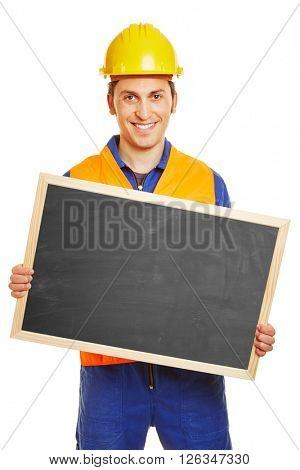 Smiling blue collar worker holding an empty blackboard