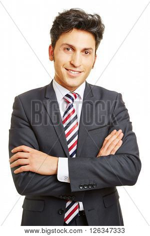 Smiling happy businessman with his arms crossed