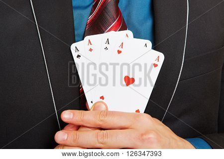 Business man holding four aces cards in his hands