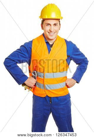 Smiling construction worker with hardhat and safety vest and protective gloves