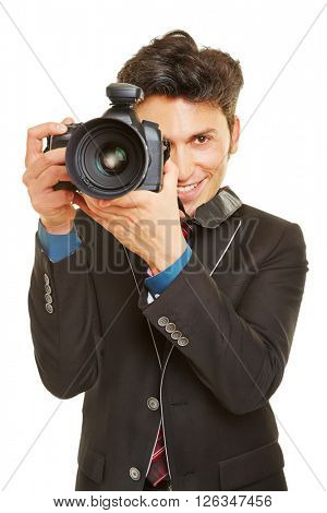 Smiling wedding photographer with modern digital camera