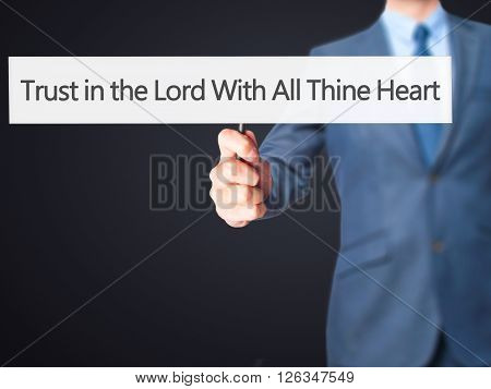 Trust In The Lord With All Thine Heart - Businessman Hand Holding Sign