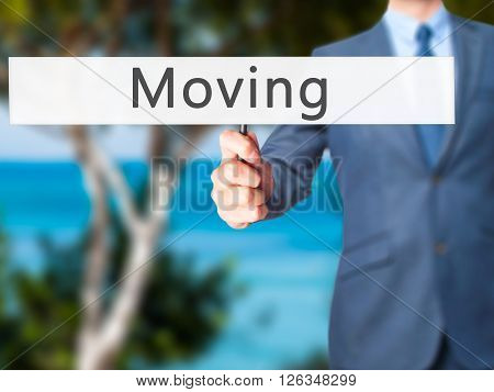 Moving - Businessman Hand Holding Sign