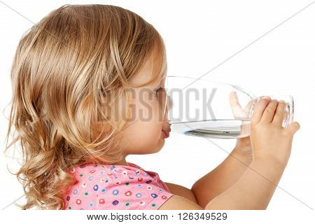 Little child drinking water isolated over white