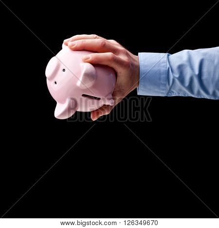 man looking for money in piggybank