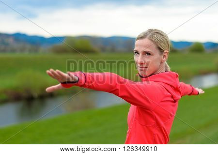 Friendly Woman Doing Exercises Outdoors