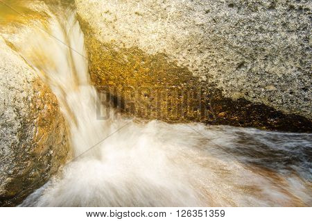 Water flowing on harden stone in the river of tropical forest