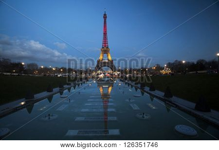 PARIS - MARCH 25: Eiffel tower illuminated with colors of the Belgian national flag to honor to victims of terrorist's attack in Brussels.