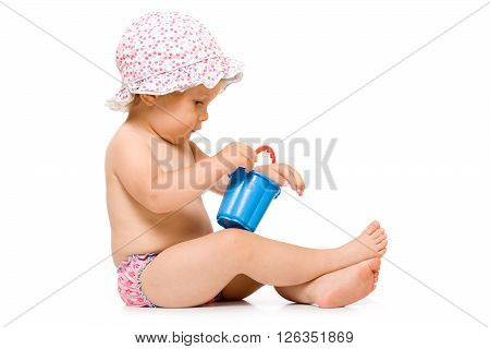 Cute child in swimming pants and sunhat, isolated over white