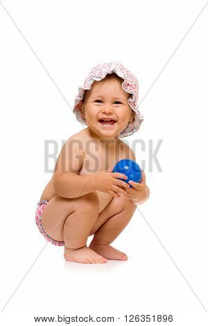Little happy child in sunhat with ball, isolated over white