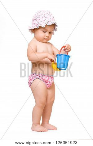 Cute baby in swimming pants and sunhat playing, isolated over white