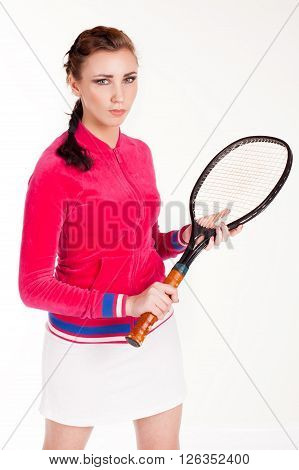 athletic nice girl with a tennis racket