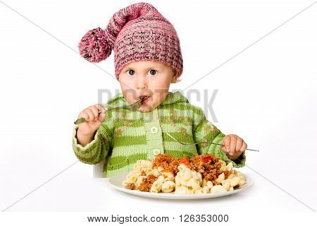 Pretty child eating pasta, isolated over white