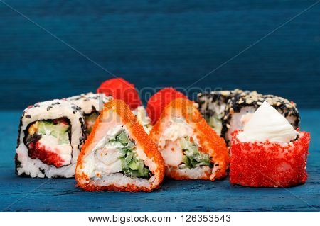 Set of various japanese fusion rolls on blue background copyspace ** Note: Shallow depth of field