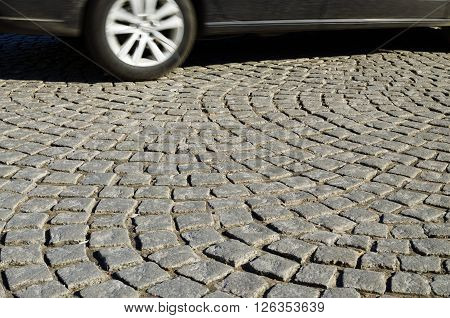 The City Of St. Petersburg.Roadway paved with small stones in the pattern.