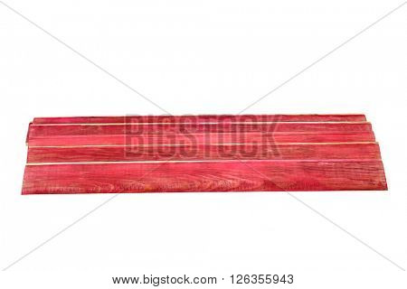 some red wooden planks on a white background