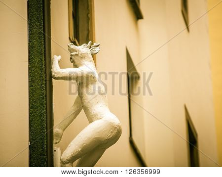 Male statue with a deer head in florence italy