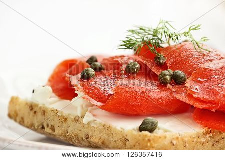 Ciabatta with Salmon Cream Cheese and Capers. Extreme shallow depth of field with selective focus.