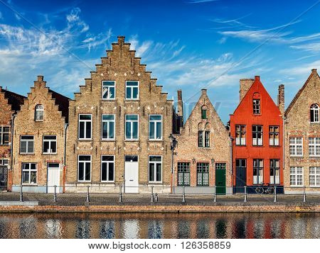Old houses and canal in Bruges (Brugge) on sunset, Belgium