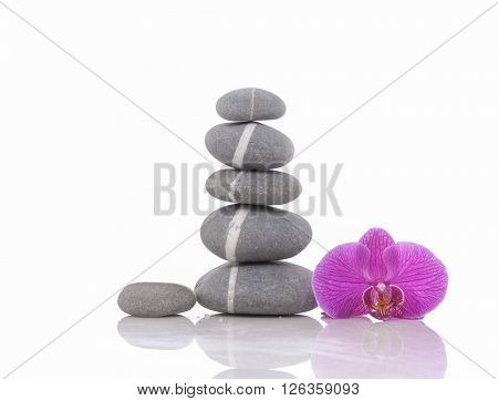 Isolated Stack of Stones with pink orchid