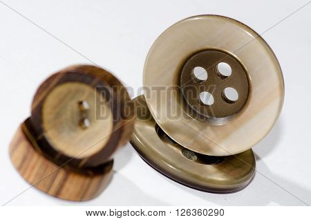Two pairs of buttons / two wooden and two plastic buttons