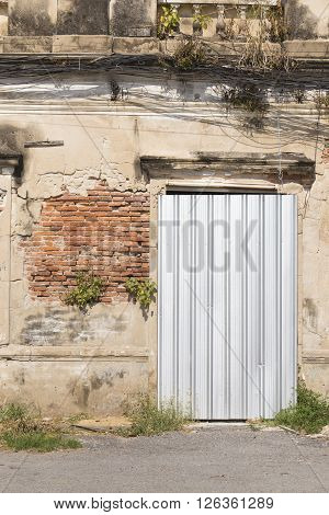 Old Abandoned Building Door Obstructed by Galvanized Sheet