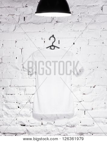 white back t-shirt on a white wall