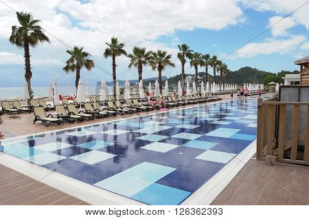 Kemer, ANTALYA, TURKEY - MAY 31, 2015: Pool  near building and trees in hotel Pirate's Beach Club, Turkey.