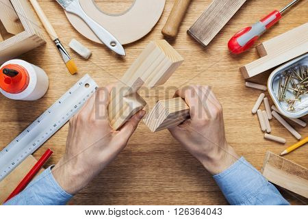 Woodworking workshop table top scene. Making of wood joint. DIY concept.