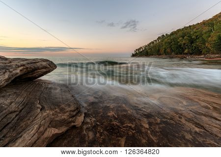 Miners Beach in the Upper Peninsula of Michigan. Easy waves ebb across the sandstone rock formations that have been here for centuries.