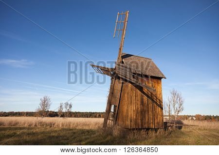 Old abandoned wind mill in Scandinavia with blue sky