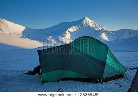 Green tent in the high mountain camp