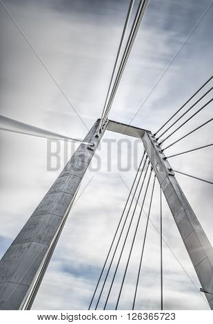 Cable Bridge in Umea Sweden with a cloudy sky.