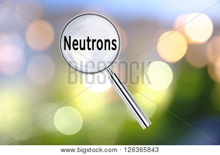 Magnifying lens over background with text Neutrons, with the blurred lights visible in the background. 3d Rendering.