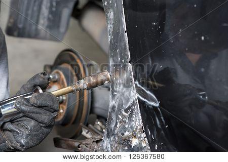 Auto body repair series : Mechanic spot welding car body