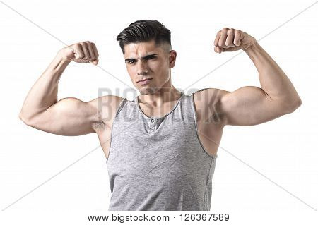 young handsome sport man posing with strong naked torso looking cool and defiant showing big shoulders and biceps in healthy lifestyle and gym club bodybuilding advertising concept