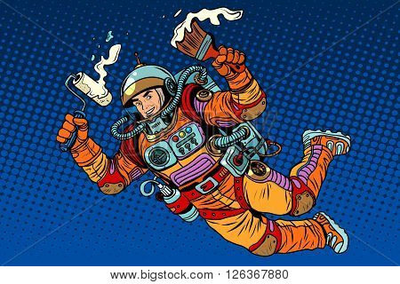 Astronaut with paint makes the repair pop art retro style. Painting and construction finishing