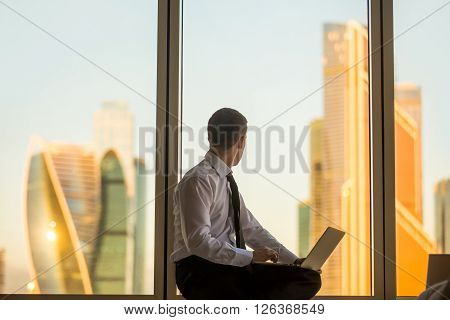 Businessman Looking At Sunrise