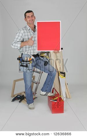 Carpenter with red panel on white background