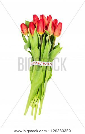 Bouquet Of Red Tulips Decorated With Hearts Ribbon Isolated Over White Background. Valentines Day Co