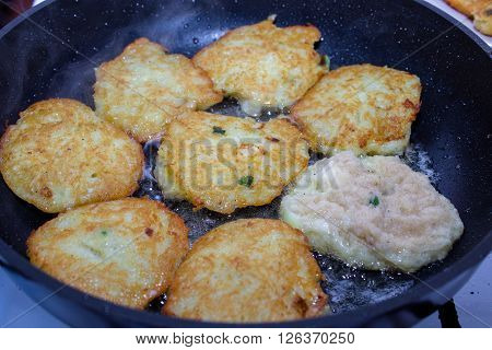 closeup hot potato pancakes in a pan prepared