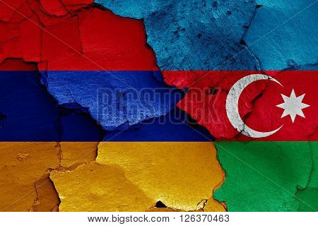 flags of Armenia and Azerbaijan painted on cracked wall