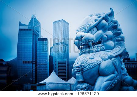 closed-up view of stone lion,shanghai famous skyscrapers,blue stoned image.