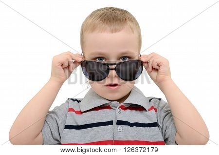 Boy Looking Over His Glasses On A White Background