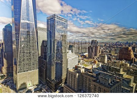 Aerial view on Lower Manhattan in New York USA and Jersey City New Jersey USA on the background. East River separates New York and New Jersey.