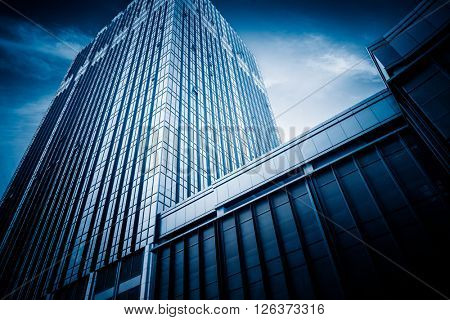 Facade of skyscrapers, low angle view,blue toned image.