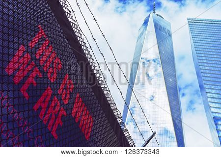 NEW YORK USA - APRIL 24 2015: One World Trade Center and Lettering in Lower Manhattan New York City USA. It is One WTC in short or Freedom Tower
