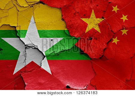 flags of Burma and China painted on cracked wall