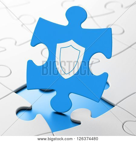 Safety concept: Shield on puzzle background