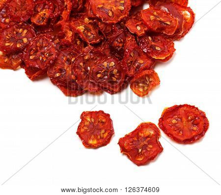 Dried slices of tomato. Isolated on white background.